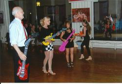 "Dr. David Taber, teacher Jan, Marilou & Aislynn dancing Cha Cha at the ""Dance for the Cure"" 2013"