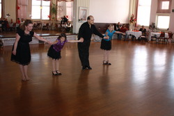 Breanna & Jocelyn dancing with teachers Gina & Jim at the Princess City Showcase